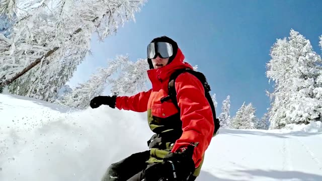 SLO MO Freestyle snowboarder skiing through the forest video