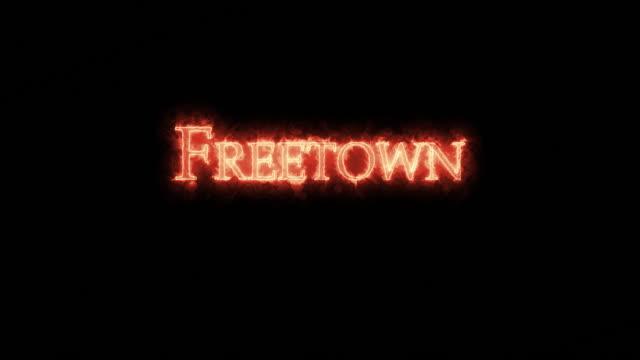 freetown written with fire. loop - sierra leone video stock e b–roll