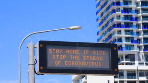 Freeway Coronavirus Warning Sign COVID-19 Freeway Coronavirus Warning Sign Along Freeway. Example Of Community Signage During Australian COVID-19 restrictions. covid stock videos & royalty-free footage