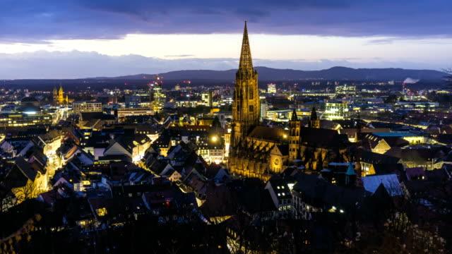 stockvideo's en b-roll-footage met freiburg in duitsland bij zonsondergang, timelapse - twilight
