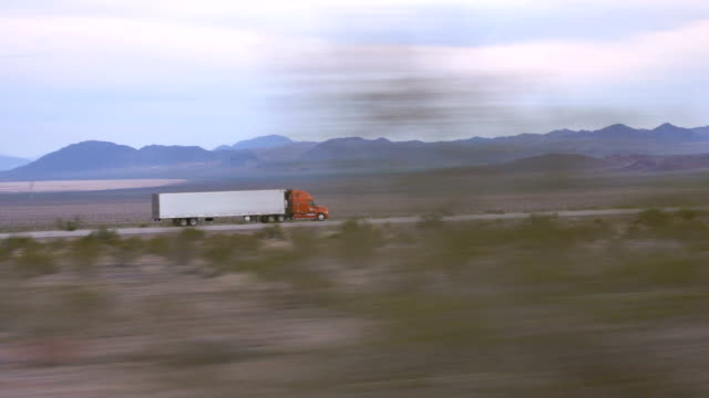CLOSE UP: Freight semi truck driving and transporting goods on busy highway video