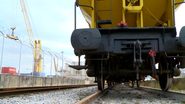 Freight train in harbor dolly to left video