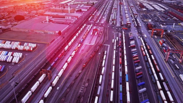 Freight Train in Industrial Shipping Yard - Aerial video