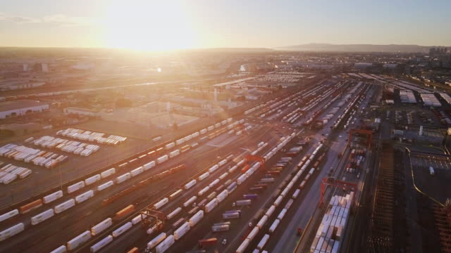 Freight Train Intermodal Yard at Sunset - Aerial Shot video