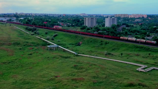 Freight train moving near residential area Freight train moving near residential area gas pipe stock videos & royalty-free footage