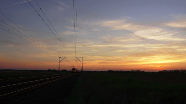 T/L Freight Train Passing By At Dusk video