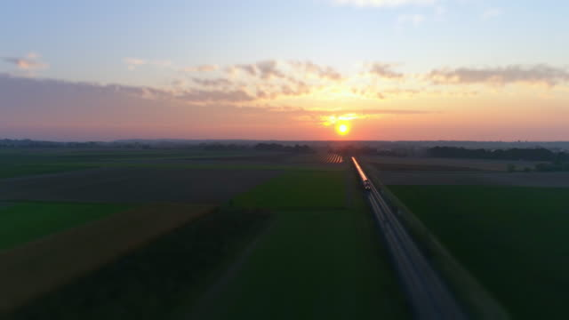 Freight Train Passing Through Countryside At Sunset video