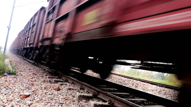Freight train passing through railroad station Freight train passing through railroad station. railroad track stock videos & royalty-free footage