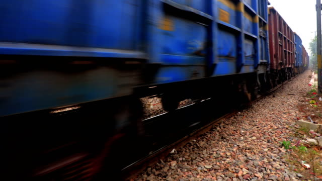 Freight train passing through railroad station video