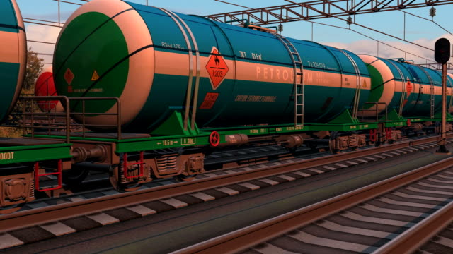 Freight train with petroleum tank cars passing by