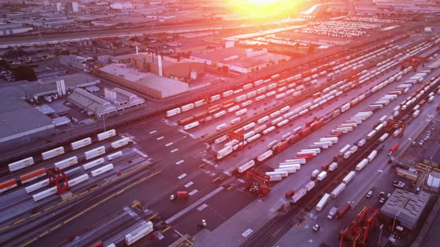 Freight Trains and Warehouses in Industrial District - Aerial View video