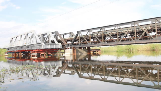 Freight trains ran on the old iron bridge. video