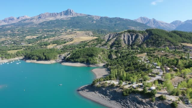french alps with turquoise waterspace of artificial lake serre-poncon - hautes alpes stock videos & royalty-free footage