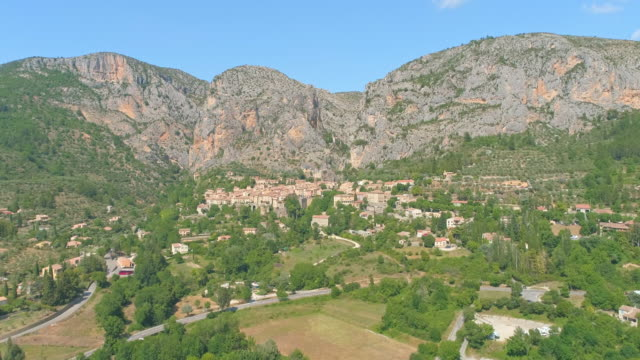AERIAL French ancient village in Provence Drone shot of a majestic French ancient village in Provence. Moustier St. Marie. France provence alpes cote d'azur stock videos & royalty-free footage