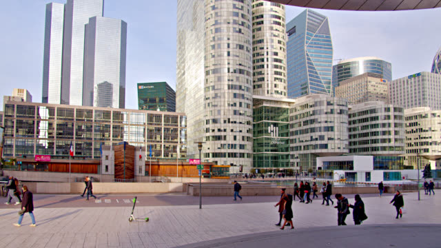 French Buildings in Financial District. People Walking.