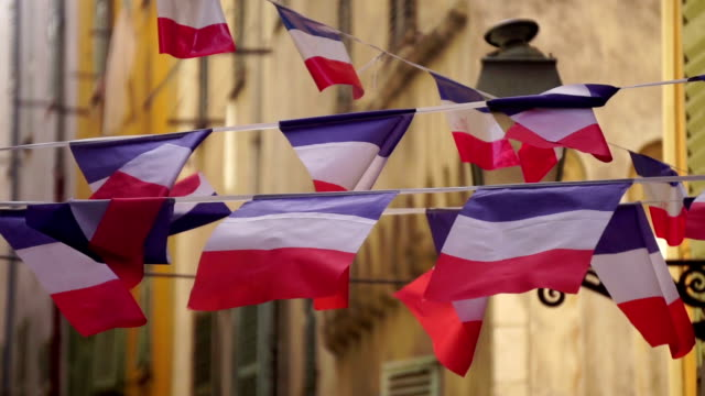 French flag bunting French flag bunting hanging in a small street in the city of Nice bastille day stock videos & royalty-free footage
