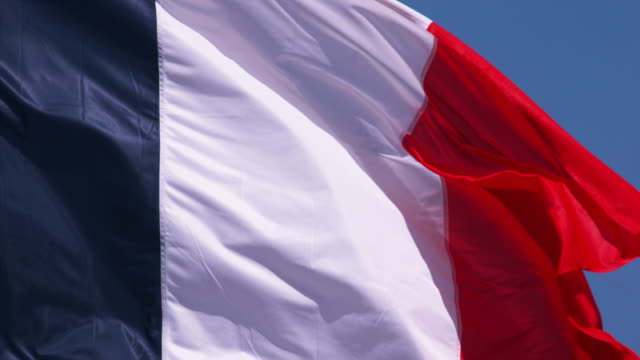 French Flag Waving in the Wind, Slow Motion 4K French Flag Waving in the Wind, Slow Motion 4K caen stock videos & royalty-free footage