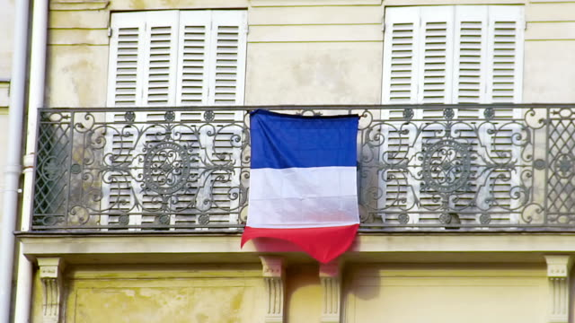 French flag waving in wind on balcony, love for motherland, patriotic feelings - vídeo