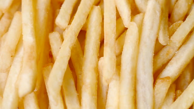 French fries close up French fries close up right rotated background french fries stock videos & royalty-free footage
