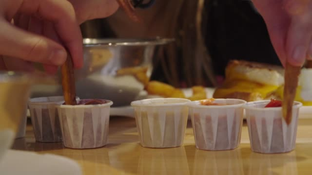 french fries dipping into sauces - соус стоковые видео и кадры b-roll
