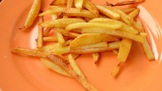 French fries on a plate and hash browns. video