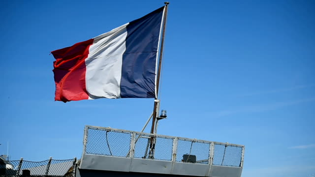 French frigate tied to a dock  in a harbor video