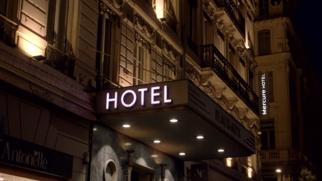 French Hotel at Night Medium shot of a hotel in Lyon, France at night. french architecture stock videos & royalty-free footage