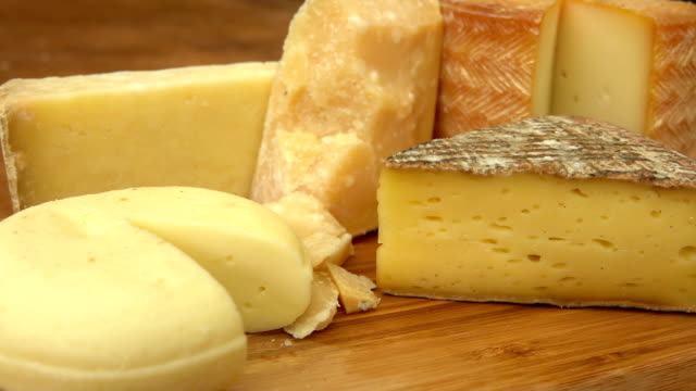 French of cheese on a wooden table. Circular movement of the camera around of pieces French of cheese on a wooden table. cheese stock videos & royalty-free footage