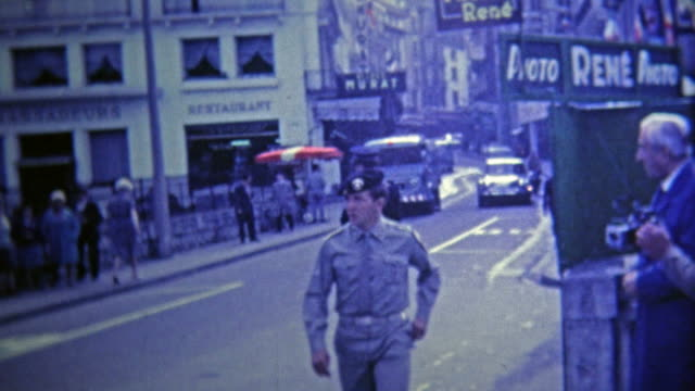 1969: French police direct traffic in the street with help of military. video
