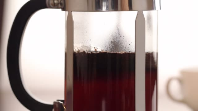 French press coffee brewing video
