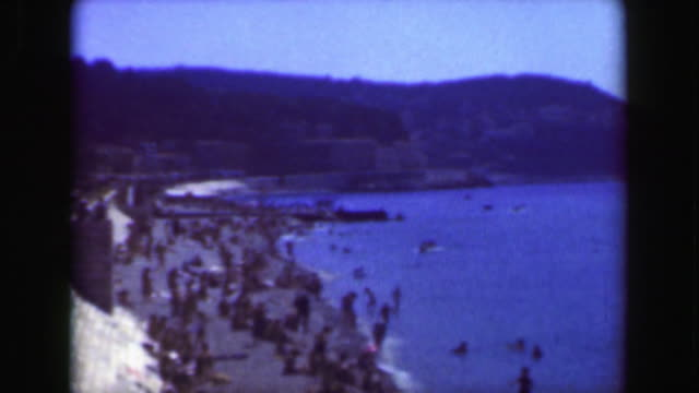 1949: French Riviera crowded beach boardwalk summer vacation blue sky.