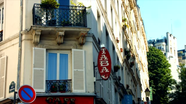 French Tobacco sign PARIS FRANCE- JULY 2, 2014: A french Tobacco sign on Ravignan street in Paris french architecture stock videos & royalty-free footage