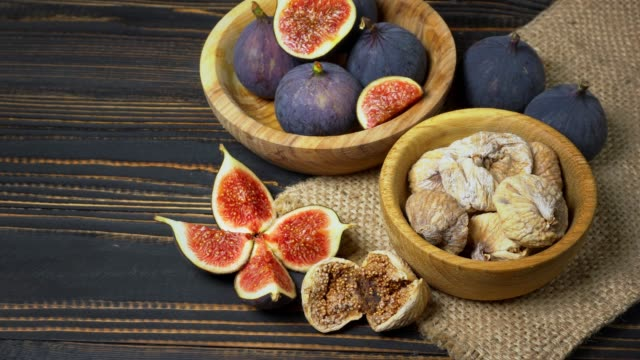 Fresh and dried Fig isolated on wooden background video