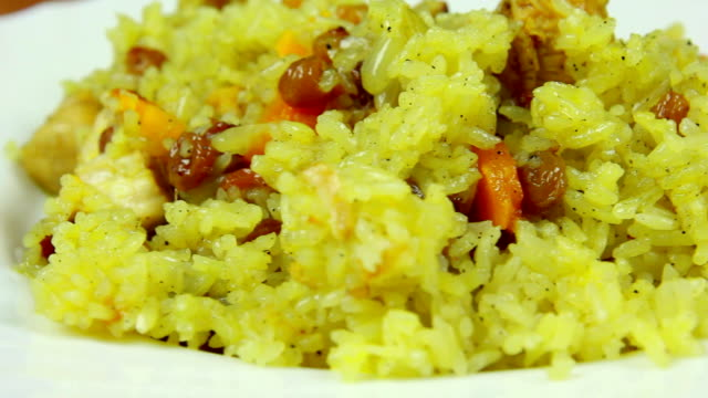 Fresh and hot pilaf in plate, dolly shot, close-up video