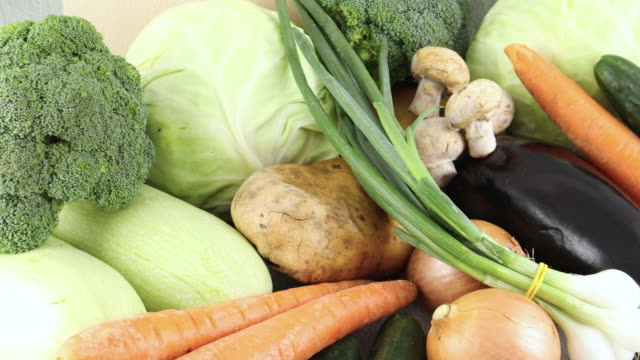 fresh and organic vegetables pile on the table - aglio cipolla isolated video stock e b–roll