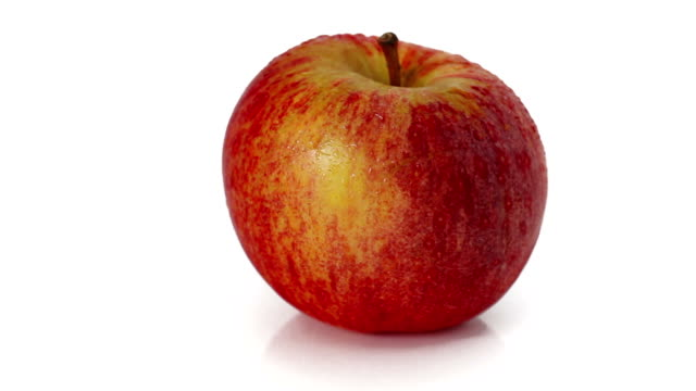 Fresh apple rotating at white background video