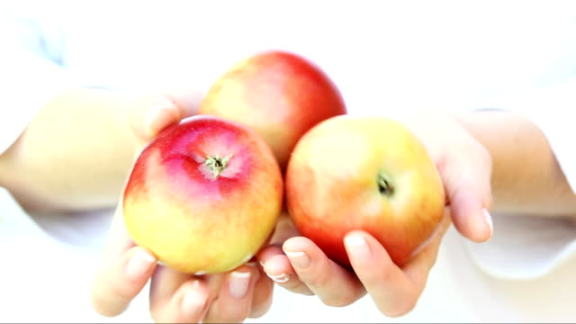 Fresh apples in woman's hands.Close up. video
