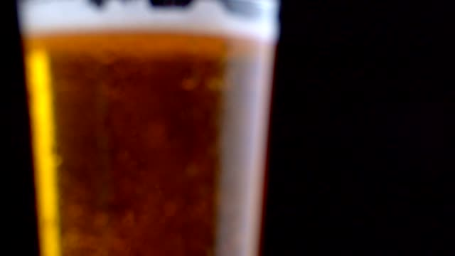 Fresh beer. Hand takes a glass with delicious craft beer. Cold fresh beer with water drops, bubbles and foam Fresh beer. Hand takes a glass with delicious craft beer. Cold fresh beer with water drops, bubbles and foam. lager stock videos & royalty-free footage