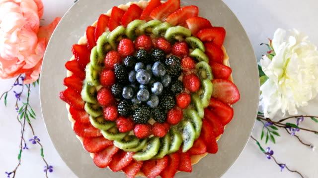 Fresh berry tart on cake stand display