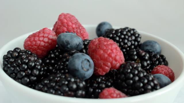 fresh blueberries, blackberries and raspberries rotating - organic food stock videos and b-roll footage