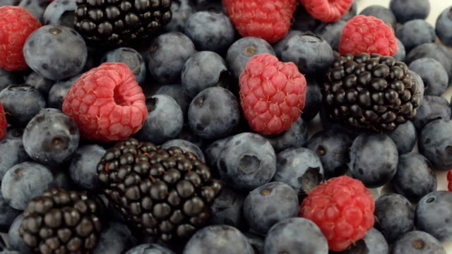 Fresh blueberries, blackberries and raspberries rotating video