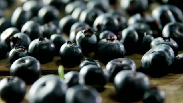 Fresh blueberries on wooden table 4k video
