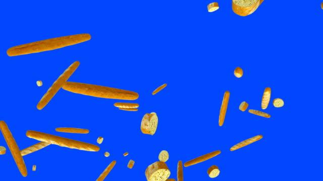Fresh bread flying in slow motion against Blue Screen