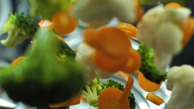 Fresh broccoli carrot and cauliflower slow motion video video