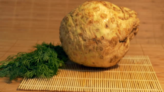 Fresh Celery Root on Table Sliding to fresh celery in the kitchen ready to be cooked. celery stock videos & royalty-free footage