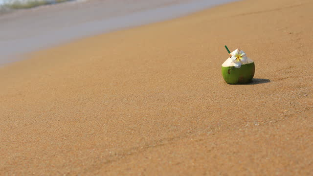 Fresh coconut juice on tropical beach.
