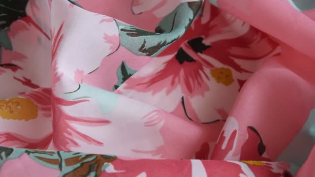 Fresh colorful folded cloth. Crop view of fashioned botanical fabric, pink and blue pastel colors Fresh colorful folded cloth. Crop view of fashioned botanical fabric, pink and blue pastel colors sari stock videos & royalty-free footage