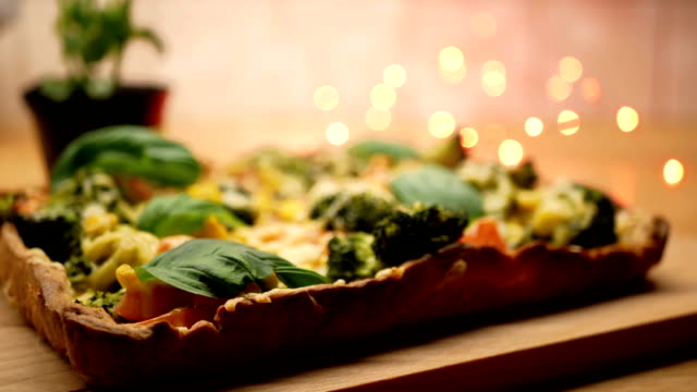 Fresh delicious home cooked pizza with steam on wood deck. video