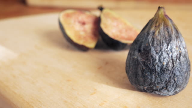 Fresh Figs on a Wooden Cutting Board - 4K video