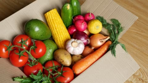 Fresh food delivery concept, quarantine covid-19 epidemic. Carton paper box packed with mixed organic vegetables close up. Container full of veggies. Delivering courier service and online shopping. Fresh food delivery concept, quarantine covid-19 epidemic. Carton paper box packed with mixed organic vegetables close up. Container full of veggies. Delivering courier service and online shopping fruit stock videos & royalty-free footage
